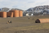huts and oil storage tanks
